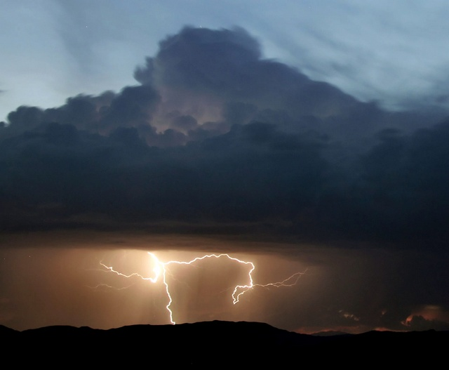 Lightning strikes near Baker, California during monsoon storm